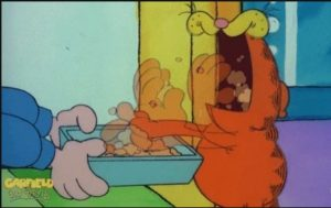 garfield-stuffing-face-with-food